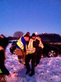 EMS removing the victim from the vehicle