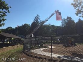 Ladder 8 with our Flag over the park.