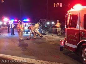 Firefighters assist in scene clean-up at tonight's crash.