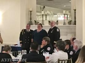 FF/EMT Regina Solecki, center, accepting the award.