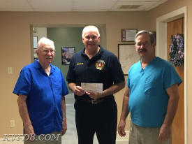 Pictured below are Dr. John Hagen (left) and Dr. Dirk Hagen (right), presenting Carl. T. Reynolds of KVFD (center) with the first installment of their gift.