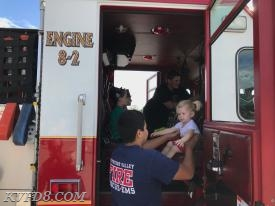 Jr. FF Gonzalez helping a new friend down after a tour on Engine 8.