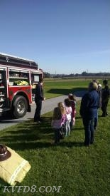 Capt. Delestienne with Engine 8 and several students.