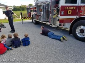 Either FF Doug Delestienne was demonstrating Stop-Drop and Roll, or he missed his naptime at the pre-school.