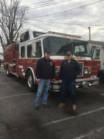 Chief Engineer Gary Myers and FF George Budzik say good-bye to Rescue 8.