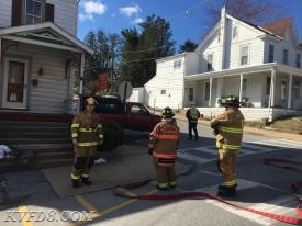 Firefighters at a vehicle into a house with a gas leak. The gas had been shut off at this point.