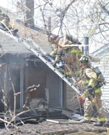 Firefighters Stackhouse and Gathercole working on the roof to the rear of the structure w/ 27 Personnel