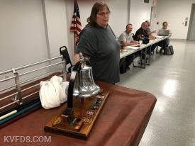 BOD member Stephanie Klingler accepting the bell on behalf of KVFD.