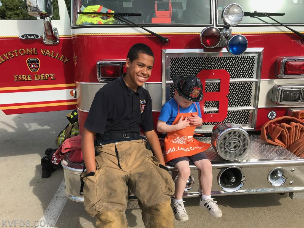 Jr. Firefighter Mike Lavender with a new friend at last year's event.