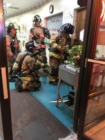Firefighter's forcing entry at today's dryer fire.