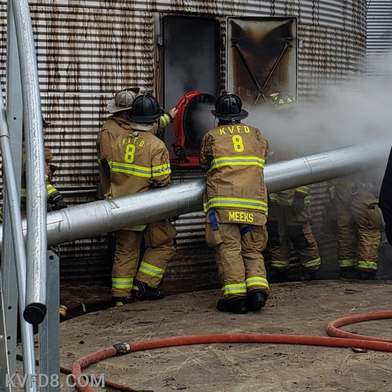 Firefighters battle a silo fire.