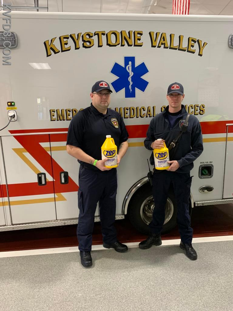 EMTs David Brandyberry & David Green with donated antibacterial disinfectant cleaner.