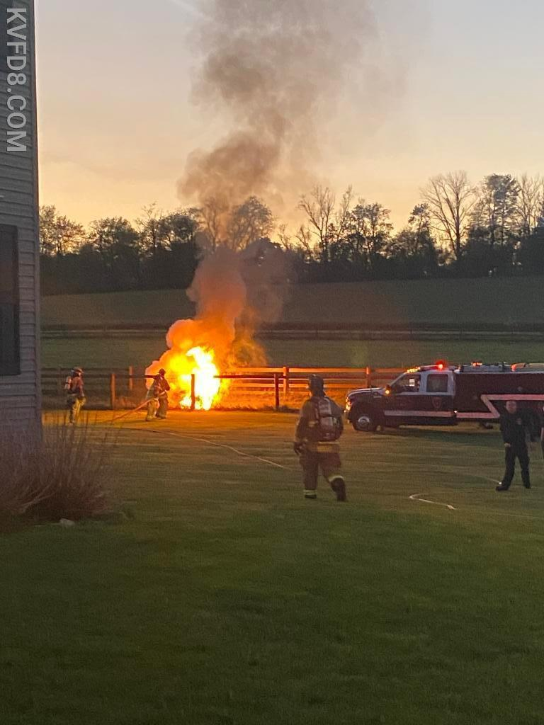 Mower on fire in Highland Township