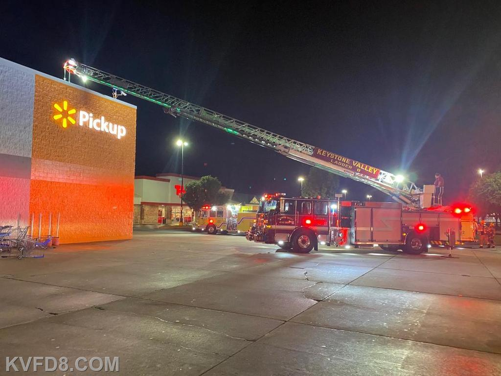 Ladder 8 set-up to the roof at Walmart