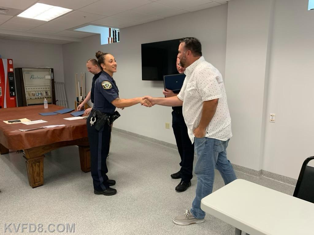 Officer Christina Farrell of Parkesburg Police being congratulated by Borough Councilmen Josh Mellinger