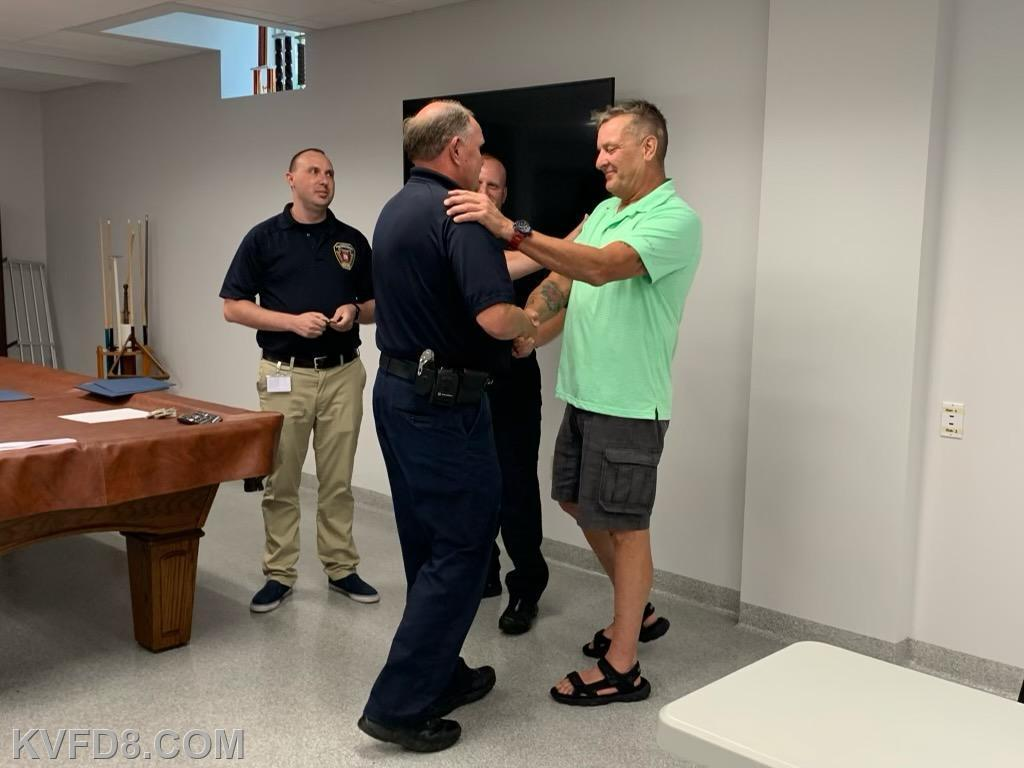 Supervisor Degnan being greeted by the patient he saved