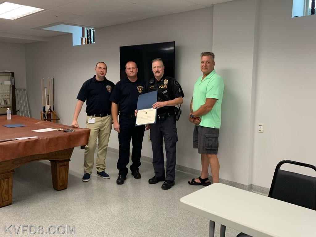 Corporal Sipple taking the recognition citation for Sadsbury Township Police